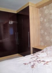 click to see larger image of Fully Fitted Bedroom Wardrobe unit in High Gloss Aubergine. Fitted in Cardiff, South Wales