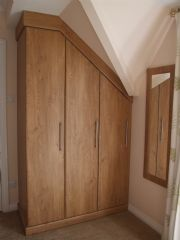 click to see larger image of Fully Fitted Bedroom Wardrobe unit with Angled Doors . Fitted in Chepstone