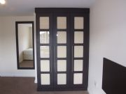 click to see larger image of Bespoke Bedroom Unit in Hacienda Black Finish with Gloss Cream Glass. Installed in Cardiff