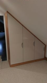 click to see larger image of Bespoke Wardrobes fitted in to an angled ceilin. Fitted in Jersey, Channel Islands