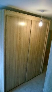 click to see larger image of Imola slinding door robe (2m) in Sonoma Oak finish. Assembed in Radyr, Cardiff, South Wales