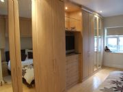 click to see larger image of Bespoke Wardrobes with lights and chests. Glass shelves. Brelade, Jersey, Chanel Islands