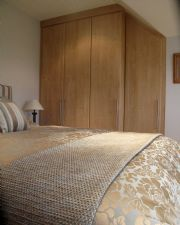 click to see larger image of Bespoke Wardrobes with angled doors. Installed in Brelade, Jersey, Chanel Islands