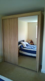 click to see larger image of Rauch Imola Sliding door wardrobe in Sonoma Oak. Assembled in Pencoed, Bridgend, South Wales.