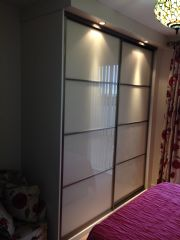 click to see larger image of Sliding Door wardrobe in Cream Gloss with Lights. Fitted in Swansea, South Wales