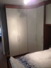 click to see larger image of Fitted Bedroom with walnut surround and white doors Installed in London SW2