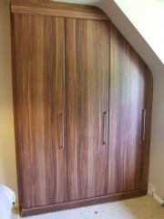 click to see larger image of Made to Measure Bedroom Unit with Angled door in Walnut. Installed in Maesteg, South Wales