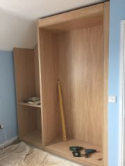 click to see larger image of Bespoke Wardrobe with open angled cupboard and drawers. Montana Oak Carcass and Gloss Ivory fronts. Fitted in Coity, Bridgend, South Wales