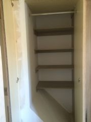 click to see larger image of Rauch Master Fitted Over Stair Well with Bespoke Interior Shelving. Fitted in llantwit Major, The Vale of Glammorgan, South Wales